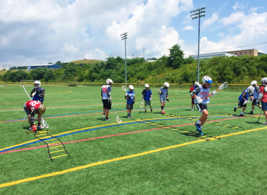 athletes playing lacrosse